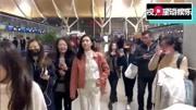 江疏影粉外套粉包少女十足 機場吃辣條與粉絲分享超可愛