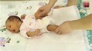 新生兒睡覺一驚一驚的是怎么回事